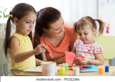 children kids girls and mother hand making at nursery or at home