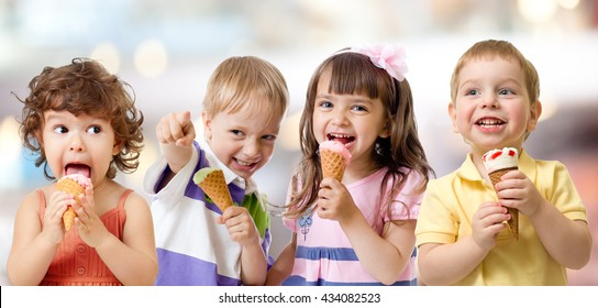 children or kids group eating ice cream