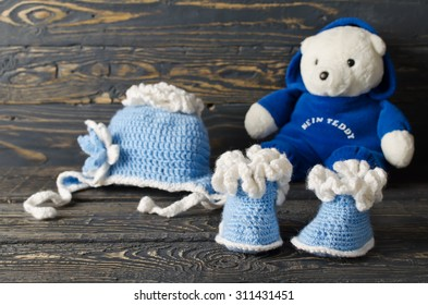 Children knitted garments for the boy. Hat and booties
