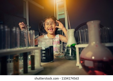 children laughing with happiness in science laboratory examination