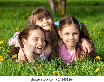 Children laying on grass. Family picnic in spring park