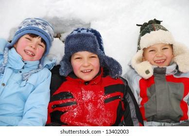 Children laying in snow