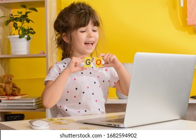 Children learn english online at home. Homeschooling and distance education for kids. Girl student study online with video call teacher.