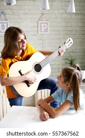 children learn to play guitar