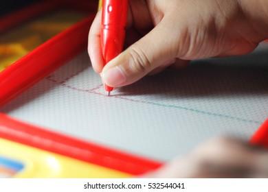 Children learn to write on the board, write, delete it.