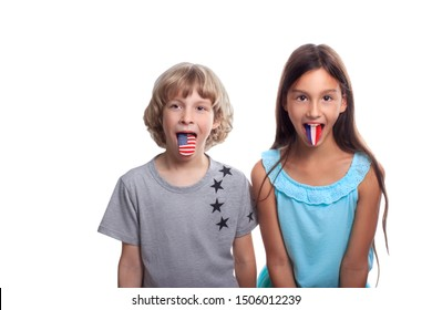 Children learning foreign languages. Blonde boy with American flag and dark haired girl with french flag on tongue isolated on white background