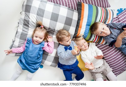 The children lie on the pillows