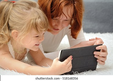 children look happy to the tablet