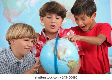 Children looking at a globe