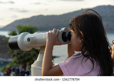 Children looking at the sea view Through binoculars