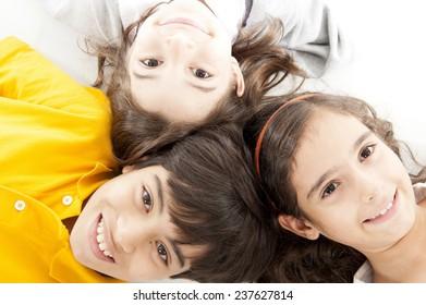 Children lying down on the floor .