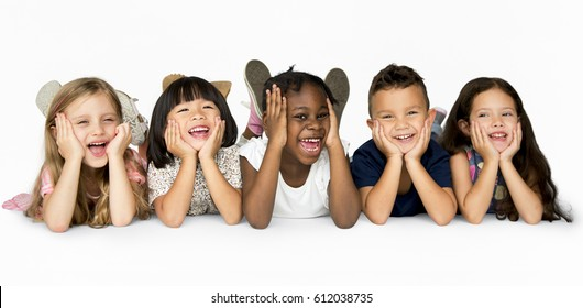 Children lying on floor hanging out