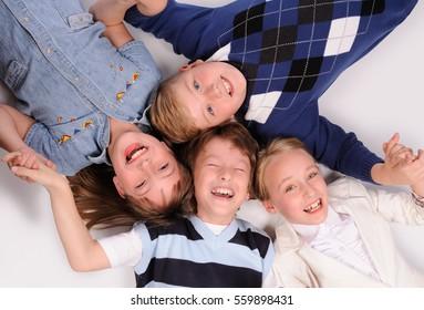 children lying on the floor isolated over white background