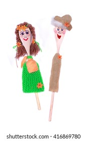 Children made puppets from wooden spoon on a white background