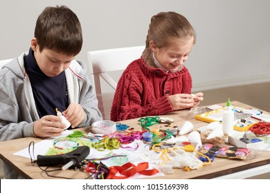 Children make crafts and toys, handmade concept. Artwork workplace with creative accessories.