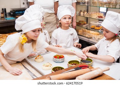 Children make flour products in a bakery