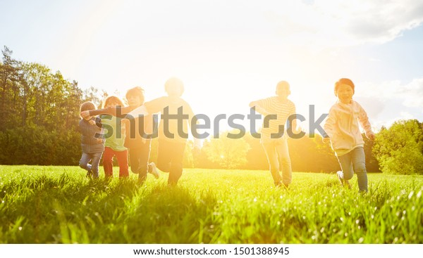 Children make race or race in the park in summer