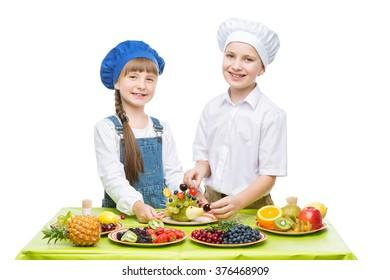 Children making fruit snacks