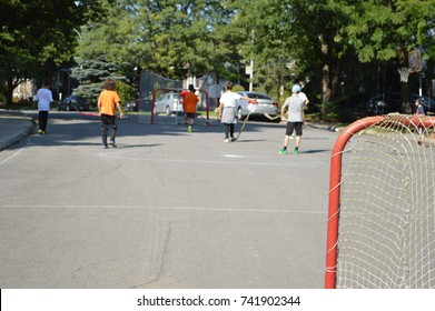 Children making sport and having fun in a street hockey game
