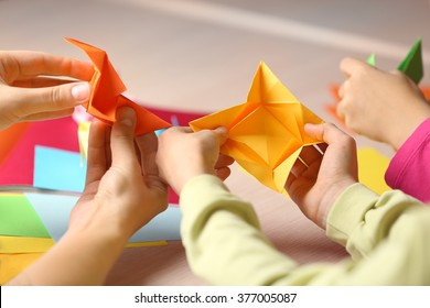 Children making swan with coloured paper