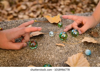 Children with marbles