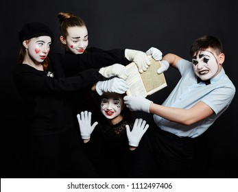 Children MIME group photo, pantomime various emotions on children's face. Baby French clown with white makeup on his face. Russia, Sverdlovsk, 26 January 2018