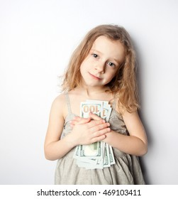 children and money , a little girl holding a Euro