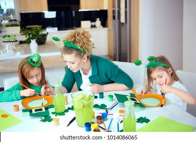 Children with mother doing decorations