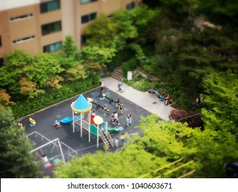 Children and mothers in the small playland