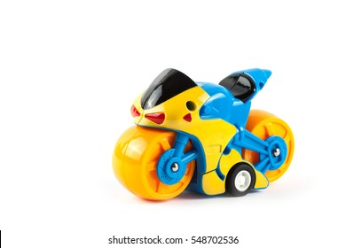 Children motorcycle toy isolated on white background.