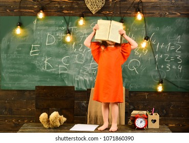 Children must be taught how to think not what to think. Learning at home. Teacher and elementary age children drawing at classroom in school. Help with homework is widely required among schoolkids now