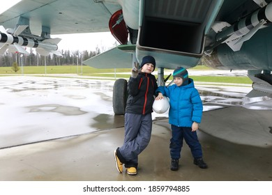 Children on background of Russian multipurpose supersonic fighter of the fourth generation Flanker-B