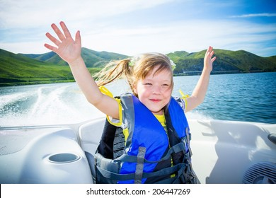 children on the boat on the river in a sunny day.