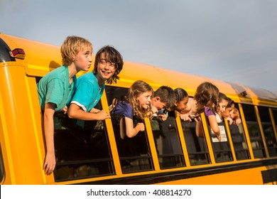 Children on the School bus - Kids hanging out the windows