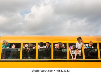 Children on the School bus - Rowdy children hanging out the window