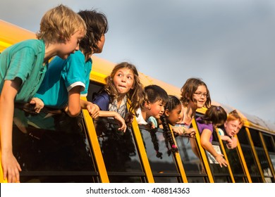 Children on the School bus - Rowdy kids hanging out the window