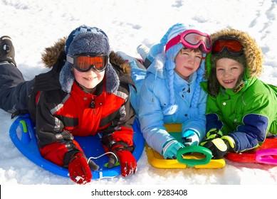 Children on sleds in snow