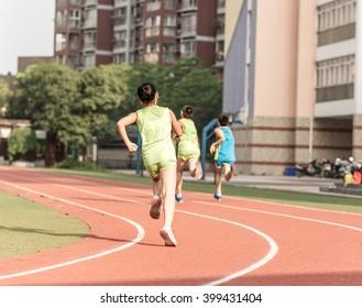 children on the track of fast city marathon