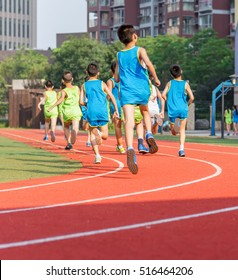children on the track of fast city marathon