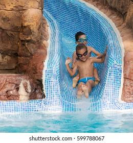 Children on a water slide in holiday resort