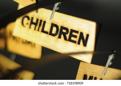 CHILDREN on a wooden sign, photograph Aspirations word