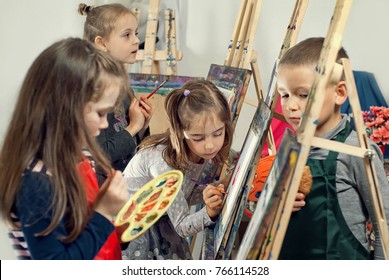 Children paint paint on canvas in a creative studio