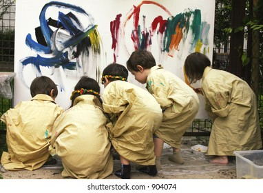 children painting on a huge canvas