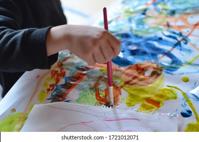 Children painting with watercolor on paper