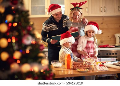 children and parents preparing cookies for Xmas eve