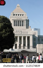 Children pass on front of the  The National Diet Building which is  the center of Japan's politics as it is the place where Diet sessions are helding in Tokyo, Japan – jan 24, 2011