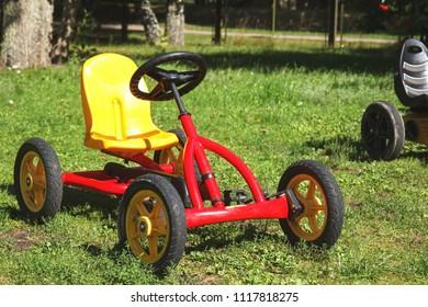 children pedal car awaiting riders at children park