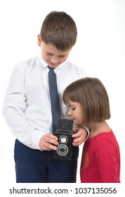 Children with a photocamera on the white isolated background.
