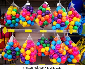 Children play colorful plastic balls in the net.