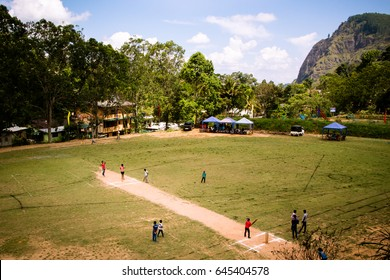 Children play cricket at the local grounds in Ella, Sri Lanka. The mountain known as Ella Rock can be seen in the background.